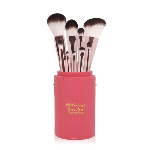 Closeup   soft touch tangerine brush set with large holder